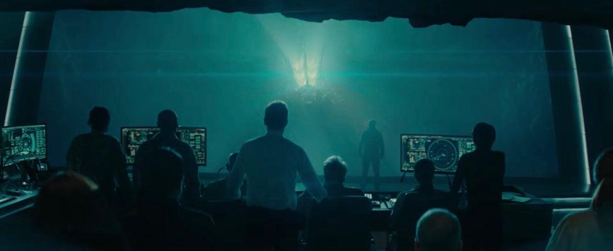 Les scientifiques regardent Godzilla