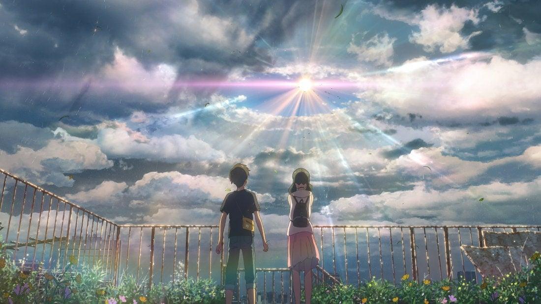 Hodaka et Hina devant le soleil dans Les Enfants du temps de Makoto Shinkai