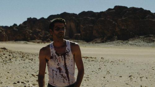 Slimane Benouari dans le désert dans Abou Leila