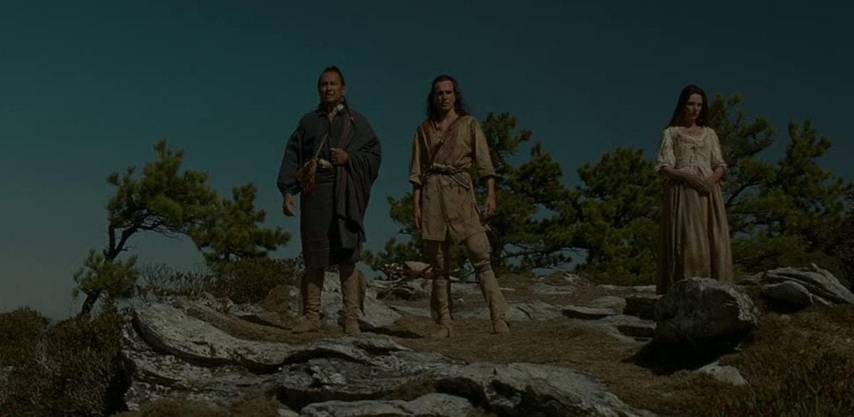 Daniel Day-Lewis, Madeleine Stowe et Russell Means dans Le Dernier des Mohicans